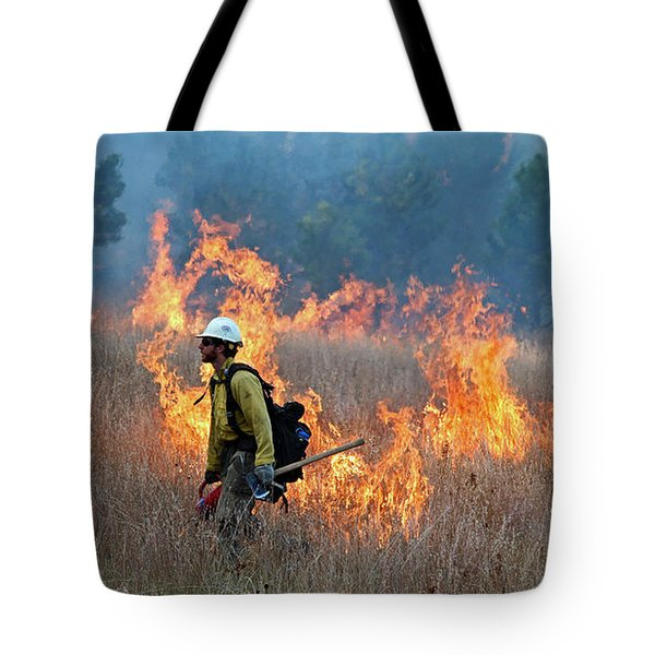 A Firefighter Ignites The Norbeck Prescribed Fire. Tote Bag by Bill Gabbert