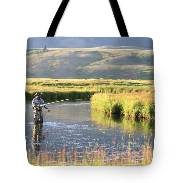 A Fly-fisherman Casts For Trout Tote Bag