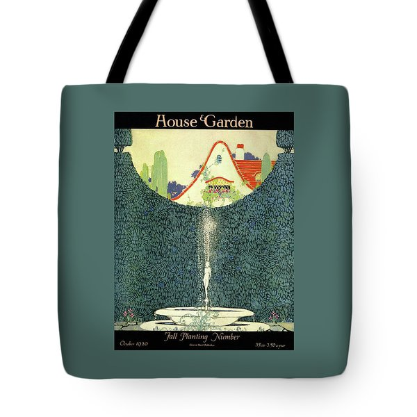 A Fountain With A Hedge In The Background Tote Bag