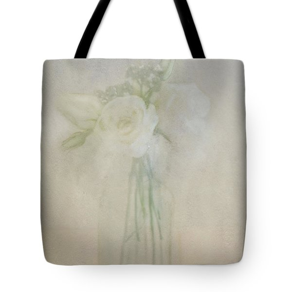 Tote Bag featuring the photograph A Glimpse Of Roses by Annie Snel