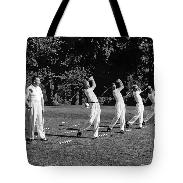 A Golf Driving Demonstration. Tote Bag