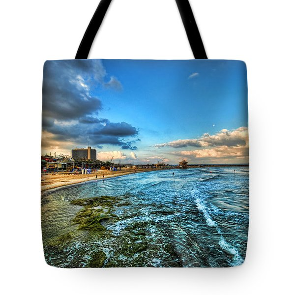 Tote Bag featuring the photograph a good morning from Hilton's beach by Ron Shoshani
