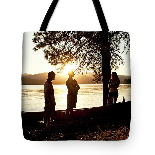 A Group Of Four Young Adults Talking Tote Bag