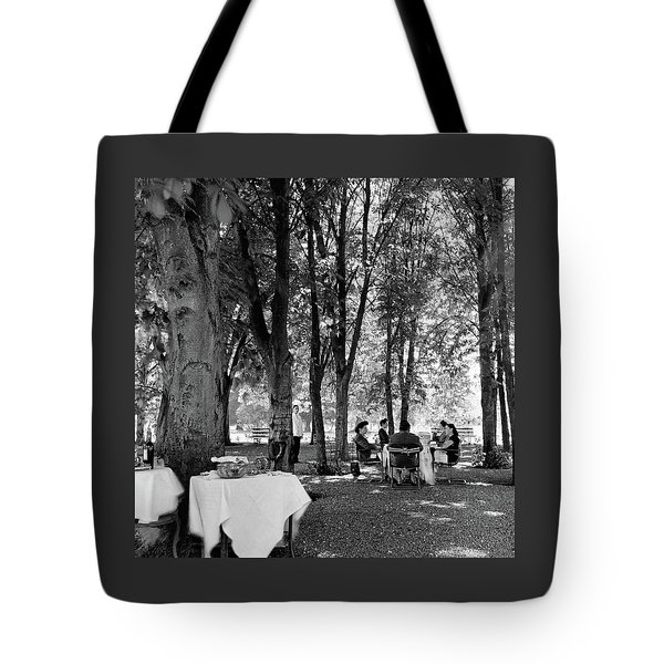 A Group Of People Eating Lunch Under Trees Tote Bag