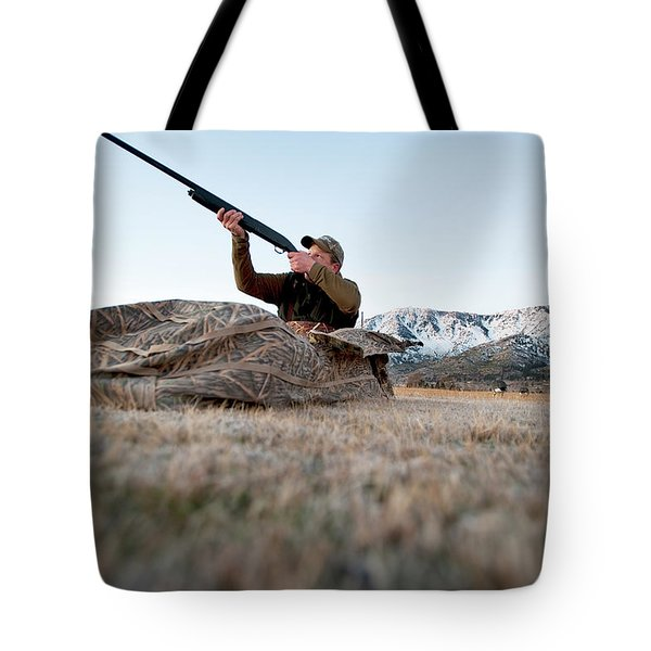 A Hunter Aims His Rifle From A Blind Tote Bag