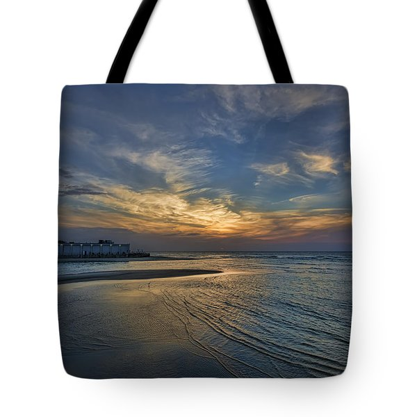 a joyful sunset at Tel Aviv port Tote Bag
