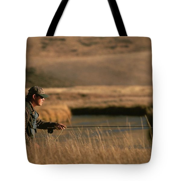 A Kneeling Fly-fisherman Casts Tote Bag