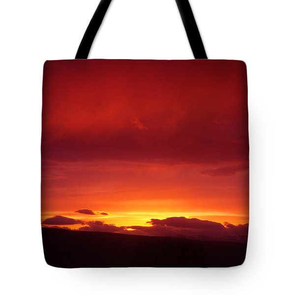A Light In The Clouds  Tote Bag by Jeff Swan