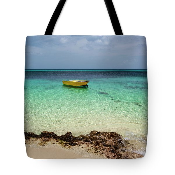 A Lone Boat In The Turquoise Water Tote Bag
