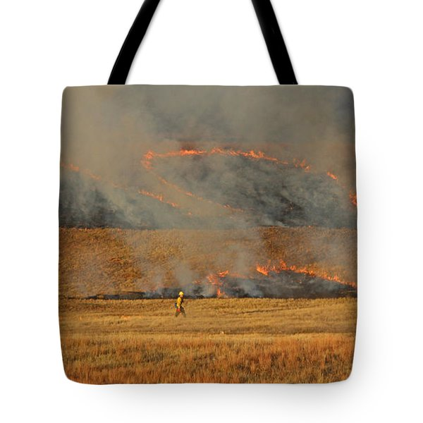 A Lone Firefighter On The Norbeck Prescribed Fire. Tote Bag