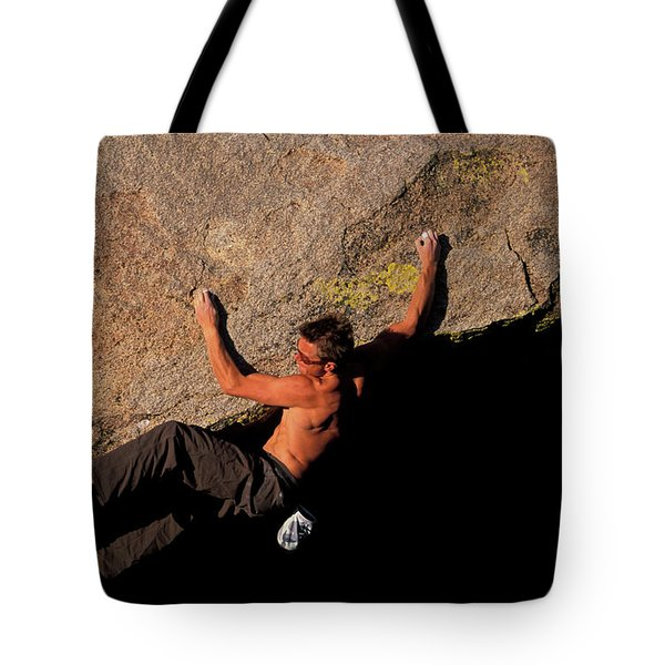 A Male Rock Climber Bouldering On An Tote Bag