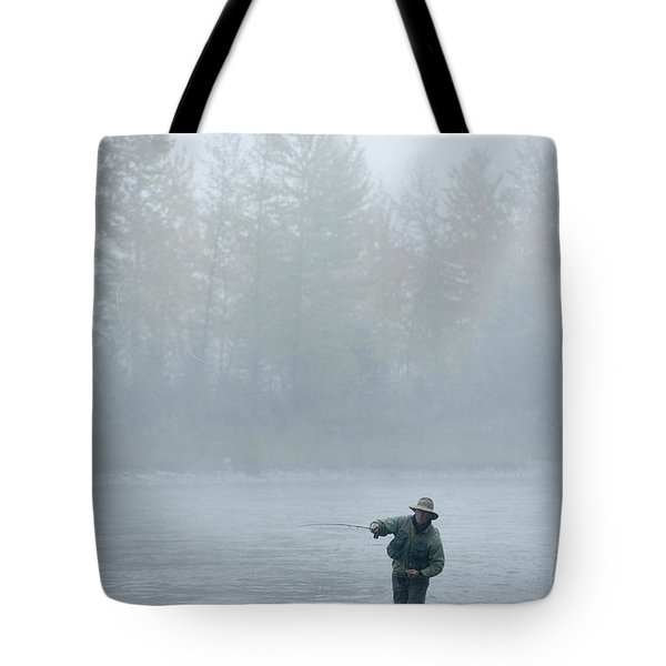 A Man Fly-fishing On Elk River, Bc Tote Bag