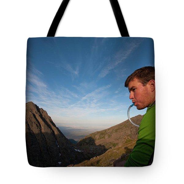 A Man Taking A Water Break On A Ridge Tote Bag