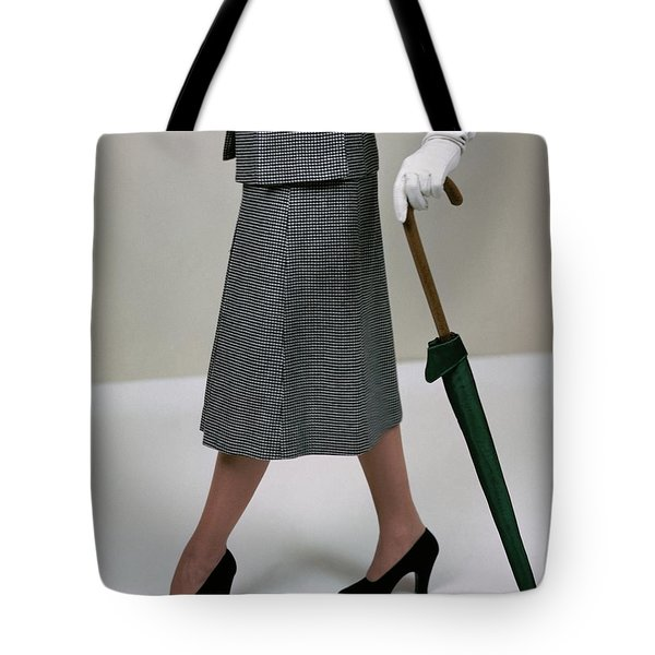 A Model Holding An Umbrella Tote Bag