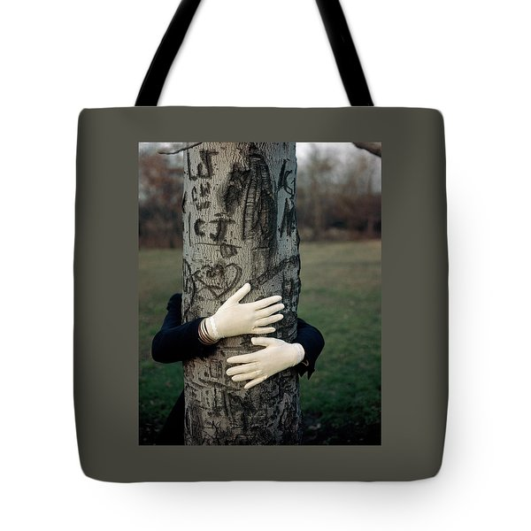 A Model Hugging A Tree Tote Bag