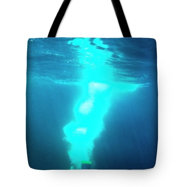 A Person Dives Down Into The Ocean Tote Bag