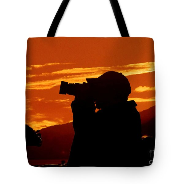 Tote Bag featuring the photograph A Photographer Enjoying His Work by Kathy Baccari