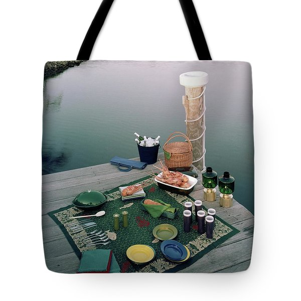 A Picnic Set Up On A Dock Tote Bag