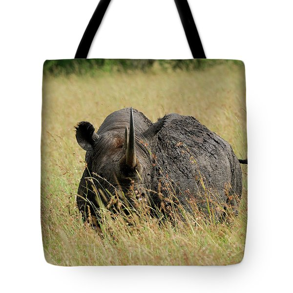 A Rhino Standing In The Grass Tote Bag