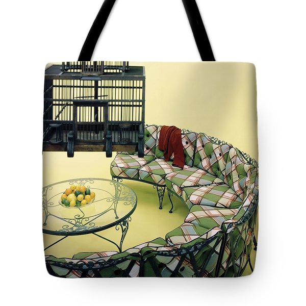 A Round Couch And A Birdcage Tote Bag