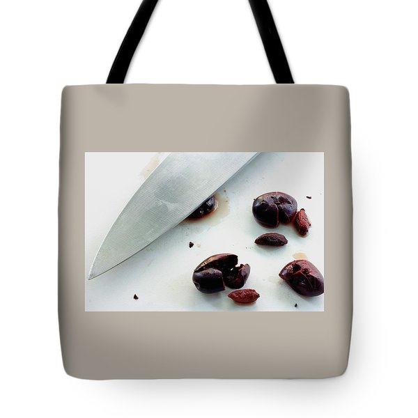 A Sharp Knife And A Group Of Olives Tote Bag