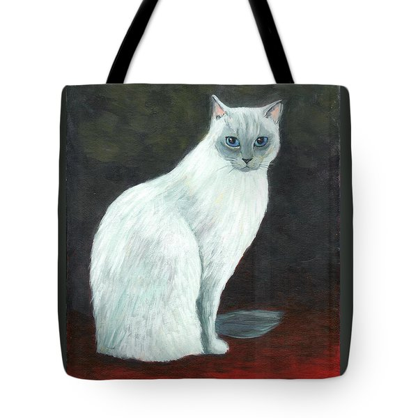 A Siamese Cat On Red Mat Tote Bag