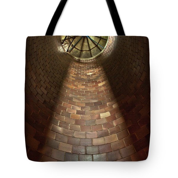 Tote Bag featuring the photograph A Silo Of Light From Above by Jerry Cowart