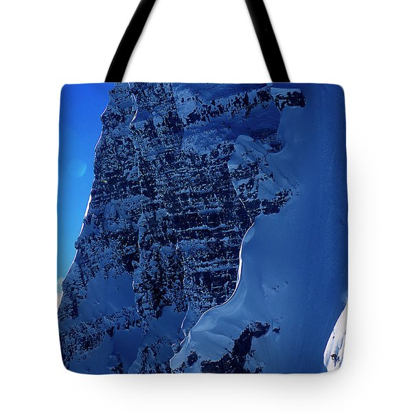 A Skier Drops From Snowy Cliff Tote Bag