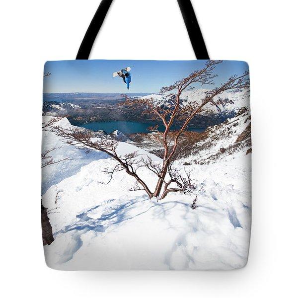 A Snowboarder Hits A Jump Tote Bag