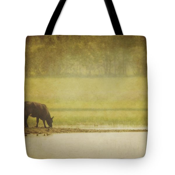 A Steer At A Pond Having A Drink In Red Tote Bag by Roberta Murray
