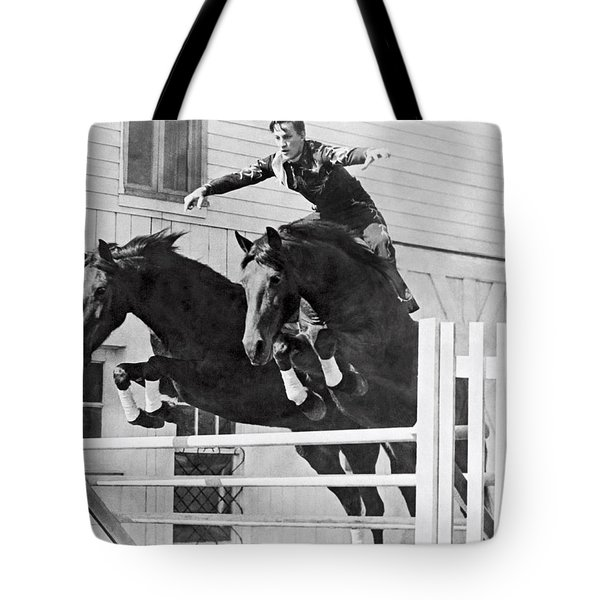A Stunt Rider On Two Horses. Tote Bag