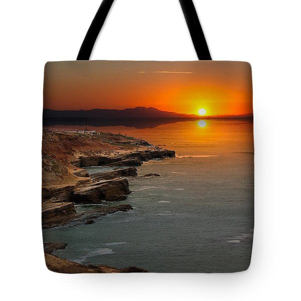 Tote Bag featuring the photograph A Sunset by Lynn Geoffroy