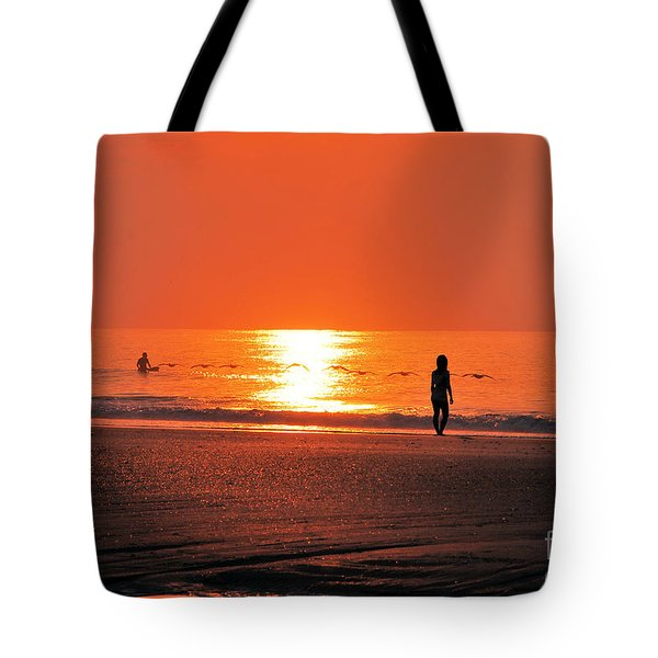 Tote Bag featuring the photograph A Surfers Sunrise On Wrightsville Beach by Bob Sample