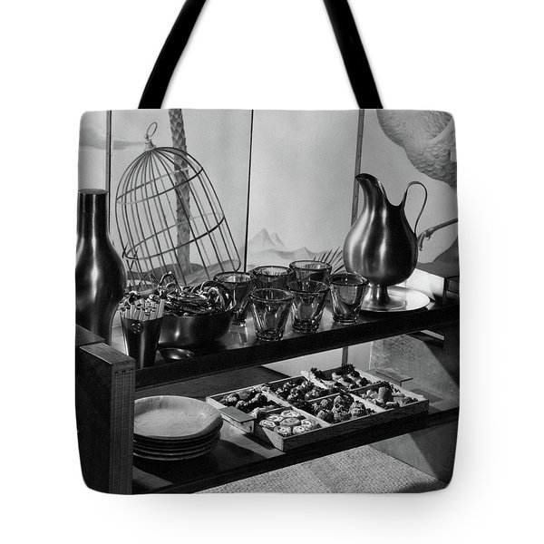 A Table With Tableware And Snacks Tote Bag