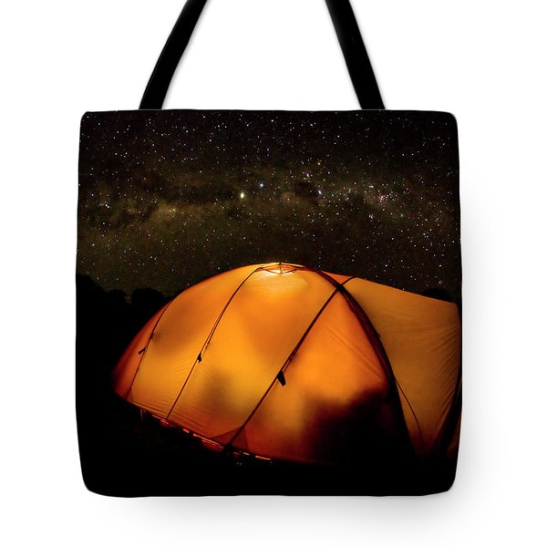 A Tent Illuminates The Night Tote Bag