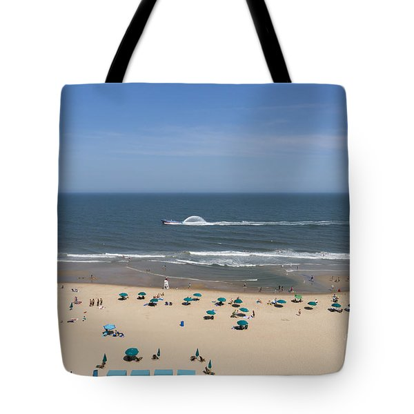 A Touring Speedboat Passes By Shore In Ocean City Maryland Tote Bag