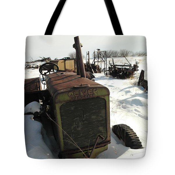 A Tractor In The Snow Tote Bag by Jeff Swan