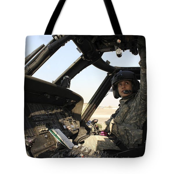 A Uh-60 Black Hawk Helicopter Tote Bag by Stocktrek Images