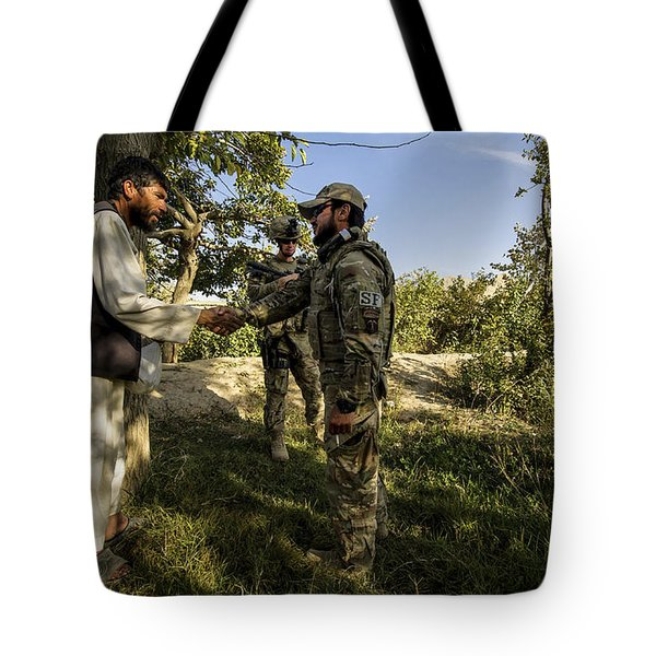 A U.s. Air Force Master Sergeant Tote Bag by Stocktrek Images