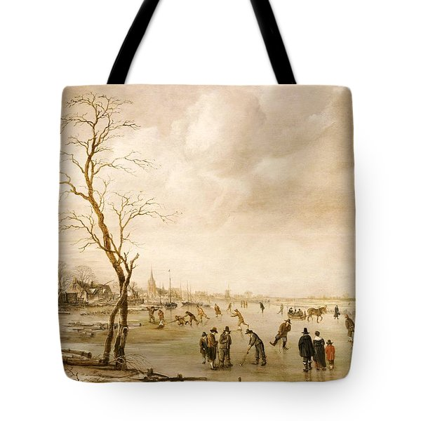 A Winter Landscape With Townsfolk Skating And Playing Kolf On A Frozen River Tote Bag by Aert van der Neer