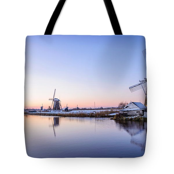 Tote Bag featuring the photograph A Cold Winter Morning With Some Windmills In The Netherlands by IPics Photography