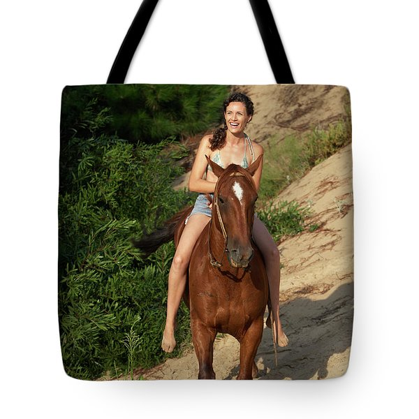 A Woman Horseback Riding Down Hill Tote Bag