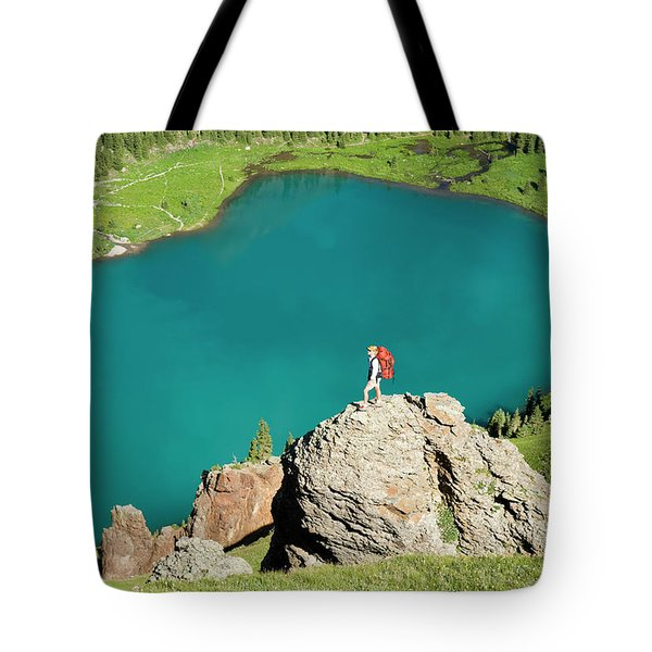 A Woman On A Rock Above Blue Lake Tote Bag
