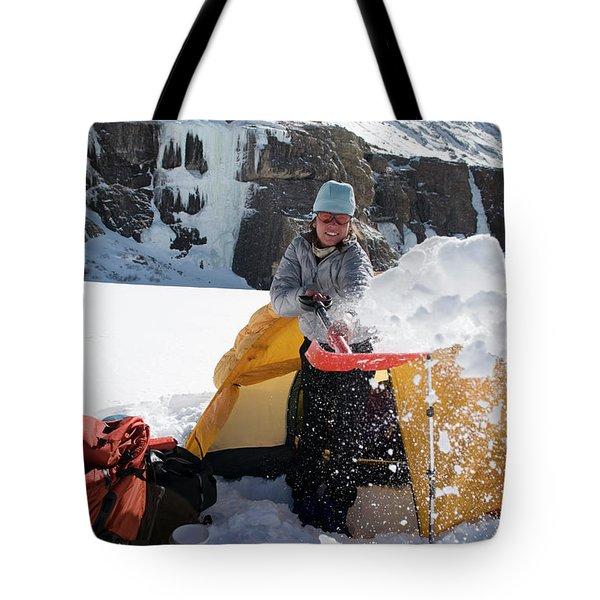 A Woman Shovelling Snow Away Tote Bag