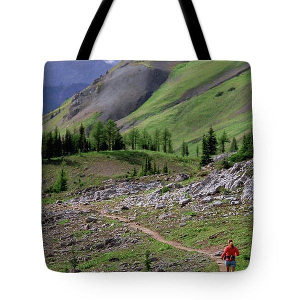 A Woman Trail Running In The Canadian Tote Bag