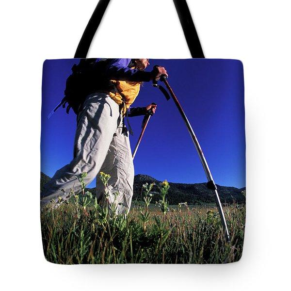 A Woman Trekking Through An Alpine Tote Bag