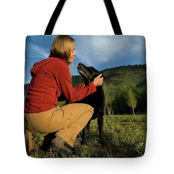 A Young, Athletic Woman Kneels Tote Bag