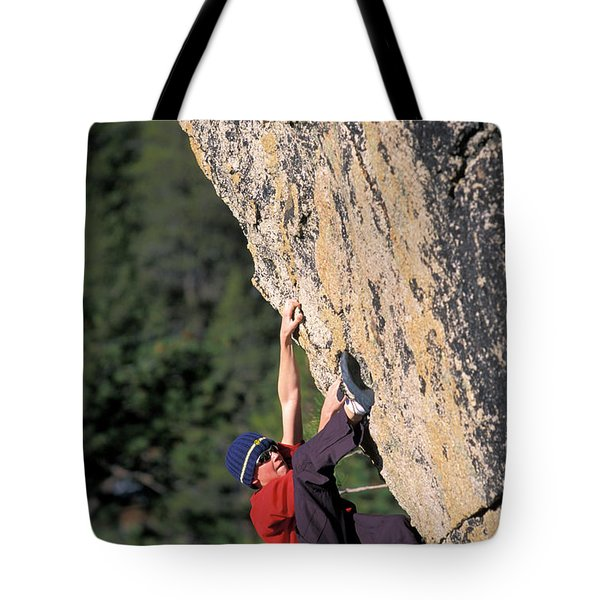 A Young Male Rock Climber Bouldering Tote Bag