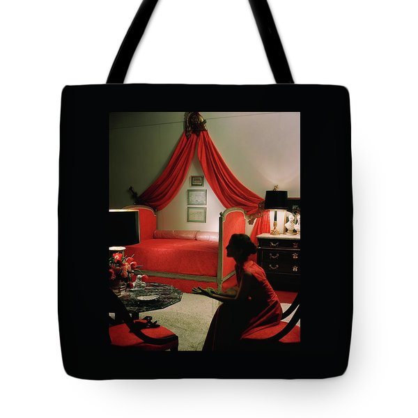A Young Woman Sitting In A Red Bedroom Tote Bag