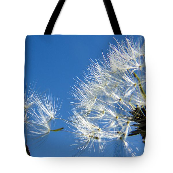 About To Leave - Dandelion Seeds Tote Bag by Darleen Stry